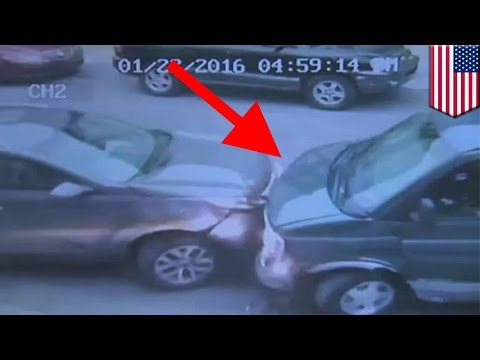 Surveillance camera: Green van smashes into parked cars after driver and passenger shot - TomoNews