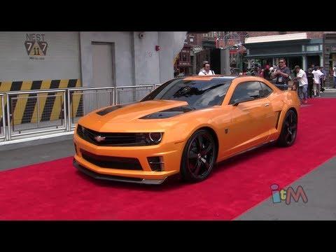 Optimus Prime, Bumblebee, Megatron transform & talk at Transformers grand opening in Orlando