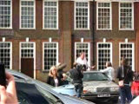 Clarkson Kissing Elaine Bedell. Jeremy Clarkson standing on