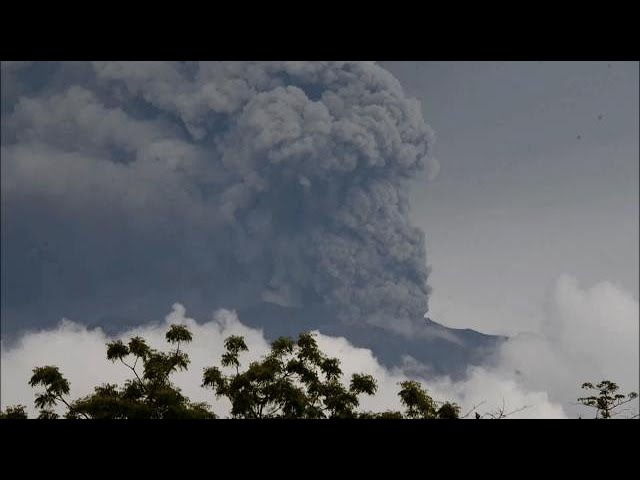 Thousands evacuated as Bali volcano spews smoke and ash