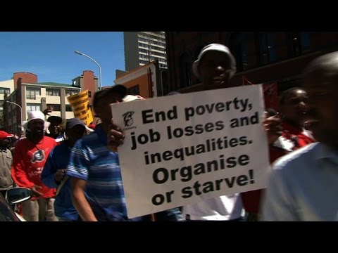 South African trade unionists march through Cape Town