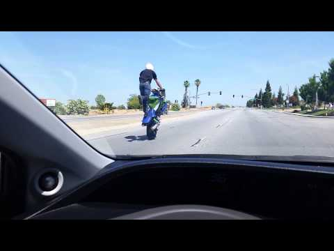 Stunt Bike rides standing wheelie w/2012 Civic Si