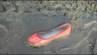 122 red ballerina flats in the mud and abandoned