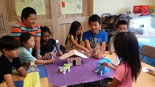 Hmong children at summer camp document their ancestors' journey to the U.S.