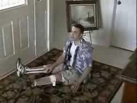 Paralyed Guy Getting Down and Up Off the Floor in Leg Braces Video
