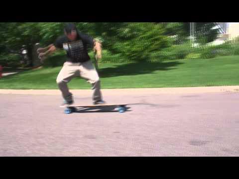 Varial Kickflip on a Longboard (Super Shaka)