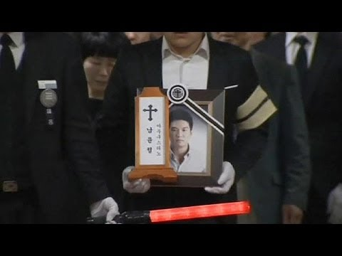 Funeral for teacher hailed a hero in South Korea ferry tragedy