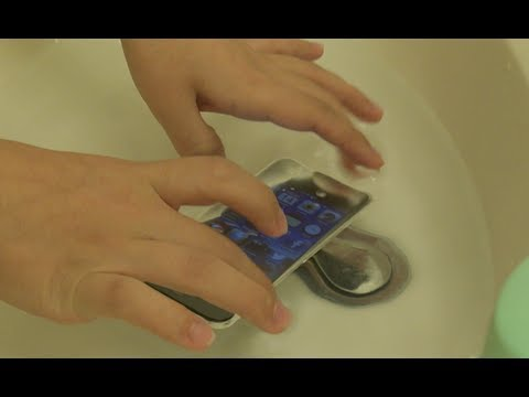 iPhone 5 Dropped in Water!!!: Winner Waterproof Skin Test