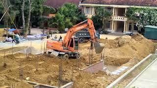 Máy múc (xúc đất đổ nền nhà)