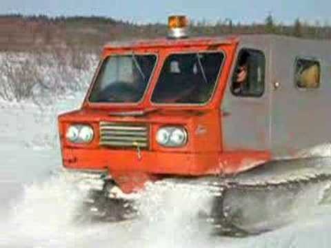 Snowtrac following Imp pulling building supplies for cabin.