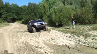Hummer H2 off roading in mud 1/2