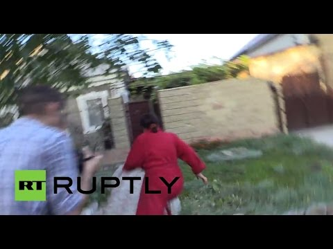 Incoming! Donetsk family narrowly escape from shelling
