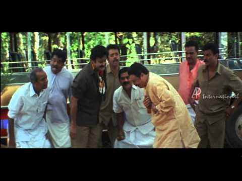 Vamanapuram Bus Route -Mohanlal puts fish in Janardanans mouth...