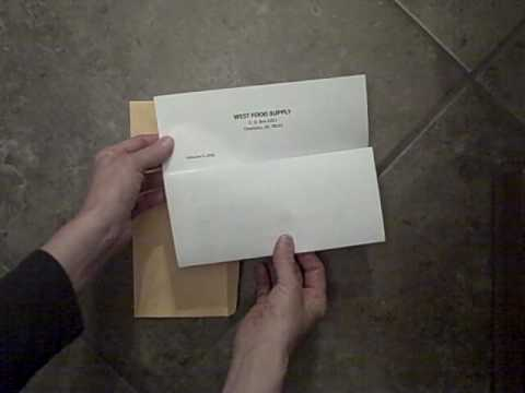 How to fold and insert a business letter into an envelope properly.