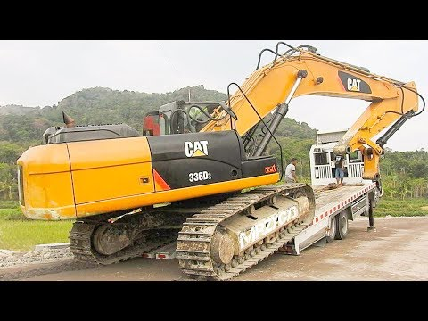 BIG Digger CAT 336D2 Excavator Moved Down The Hill By Quester Self Loader Truck