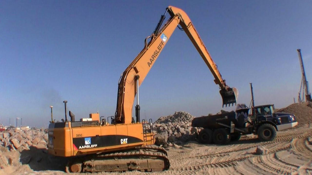 Cat 385C Long Reach Excavator Loading Volvo A40 Dumper With Boulders - YouTube