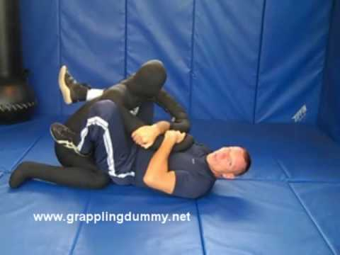 Arm Bar From Guard w/ Submission Master Grappling Dummy Image 1