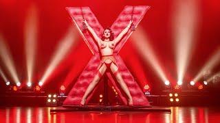 Roxi D'Lite as Madame X