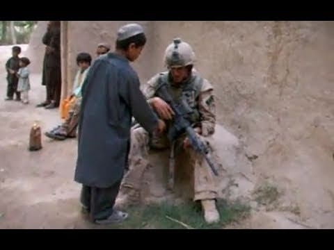 AFGHAN CHILDREN AND SOLDIERS