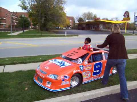 The youngest member of the Lawmen Racing Team, Marshall Gehrke, waves to passers-by at the local CARQUEST of Grayslake, doing his job to help promote sponsor...