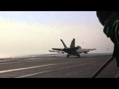 U.S. Navy F/A-18 Super Hornets are recovered aboard USS George H.W. Bush (CVN 77)