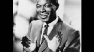 Watch Nat King Cole A Blossom Fell video