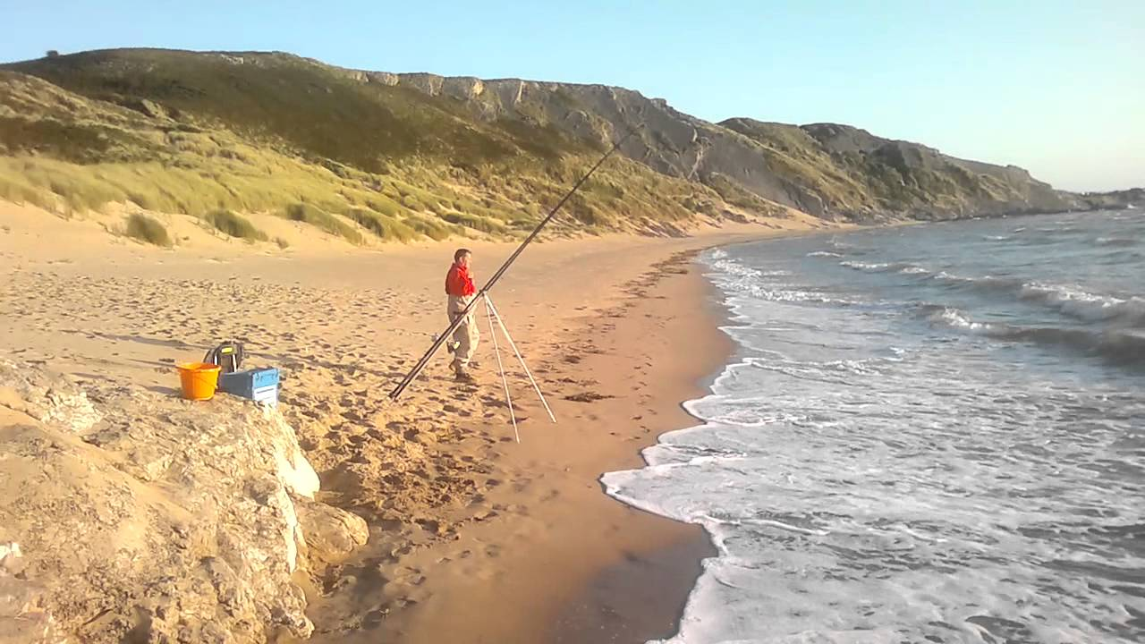 Fishing in broughton bay gower youtube for Fishing license for disabled person