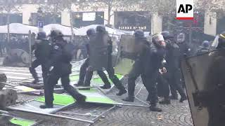 Confrontations in Paris as fuel protests escalate; water cannon