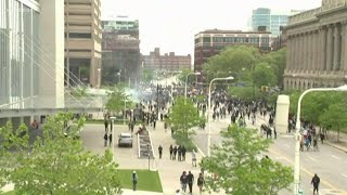 Protesters set police cars on fire in downtown Cleveland