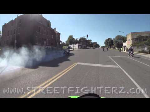 motorcycles do burnouts in oncoming traffic through cars