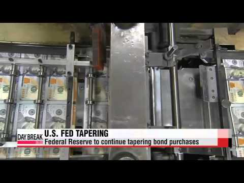 U.S. Fed continues to taper bond-buying program