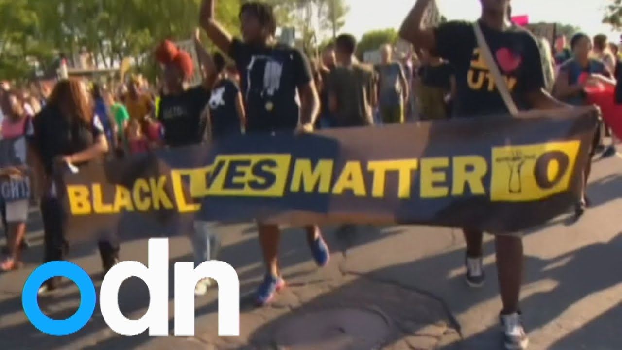 Black Lives Matter protestors march in Toronto against the police shooting of two black men