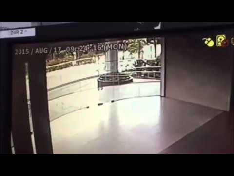 Ghost caught on CCTV breaking glass door in Singapore