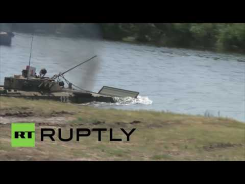 Russia: T-90 tanks show off their amphibious abilities during Volgograd drills