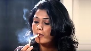 Indian woman chain smokes red cigarettes
