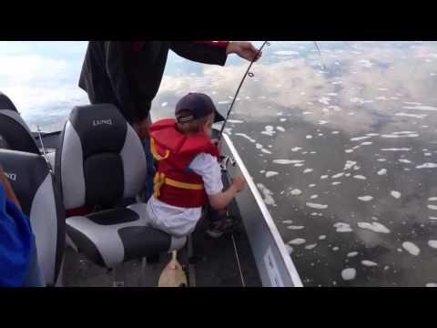 Sturgeon fishing in Winnipeg River ( 8yr old fights a Master)