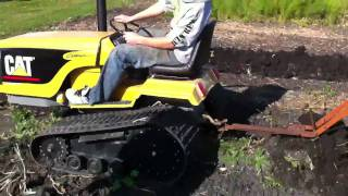 Mini Cat Challenger plowing potatoes