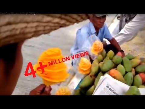 路上でマンゴーを売る男性のカッティング技術が凄い!