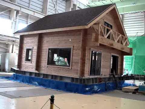 Log house on earthquake test - YouTube