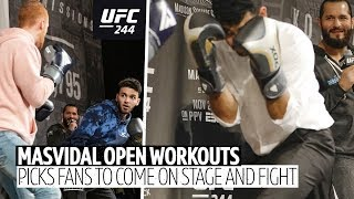 Crazy scenes 🤣 Jorge Masvidal picks fans to come on stage and fight each other during open workouts