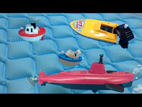Toy motor boat, toy jetboat, toy submarine for joyful summer time