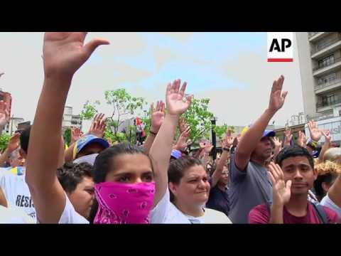 Supporters of jailed activist Leopoldo Lopez gather to demand his release
