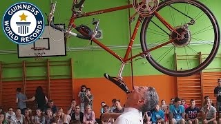 Longest duration balancing a bicycle on the chin - Guinness World Records
