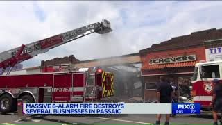 Fast-moving fire tears through businesses in Passaic