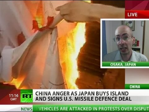 China anger as Japan buys island & signs US missile defence deal
