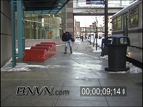12/22/2003 People walking on slippery sidewalk video