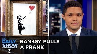 The U.N. Issues an Alarming Climate Report & Banksy Shreds His Painting   The Daily Show