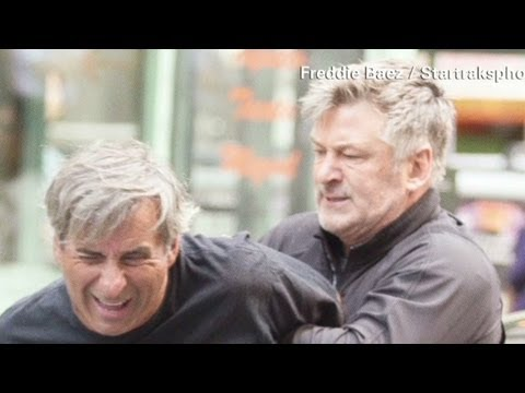 Alec Baldwin pins paparazzi against car