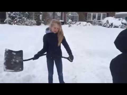 Hal Roosa shoveling snow with his sister