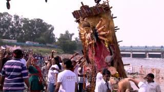 Durga Idol into the water- Durga Puja Visarjan